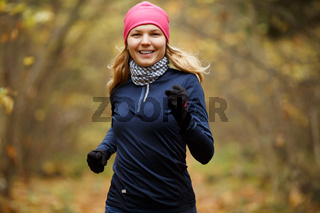 Blonde girl jogging in morning