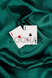 two aces on green silk