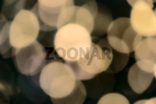 Zoomed in bokeh of blurred electric candles on a christmas tree