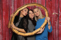 3 girls look through a golden frame and kissed