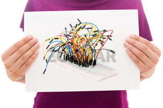 Girl holding white paper sheet with Photo of Breadboard