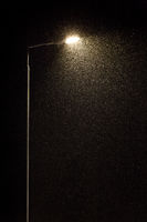 Street lamp and falling snow