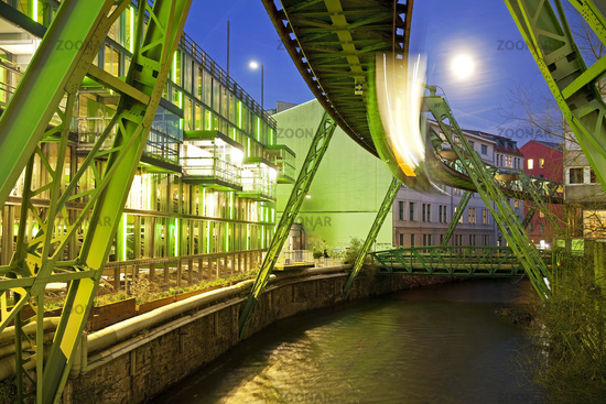 moving Wuppertal cable railway over the river Wupper in the evening, Wuppertal, Germany, Europe