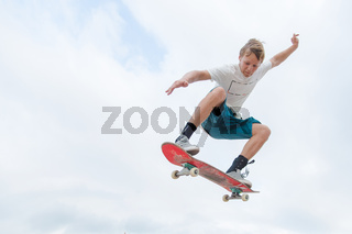Young skateboarder in a jump