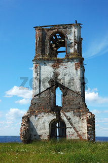 Old destroyed belfry in northern russian village Nokola