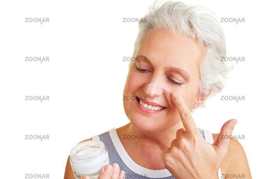 Woman looks at cream jar