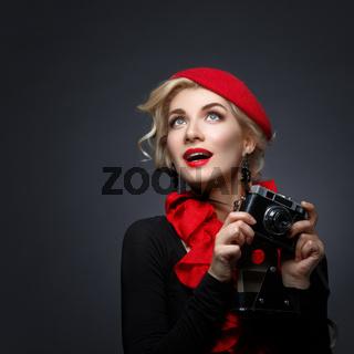 Beautiful lady with retro photo camera