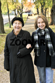 Granddaughter walking with grandmother
