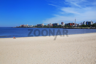 Sandy beach along the bank of the Rio de la Plata in Montevideo,