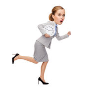 stressed young businesswoman with clock running