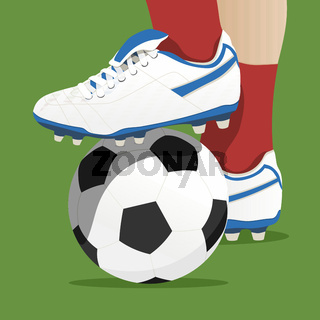 Footballer stepping on the ball in a soccer match