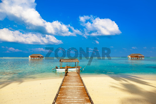 Boat and bungalow on Maldives island