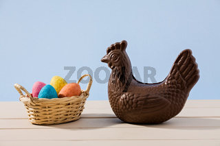 Easter chocolate chicken and eggs over a table