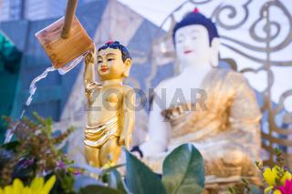 Bathing the Buddha statue