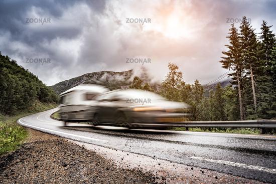 Caravan car trailer travels on the highway.