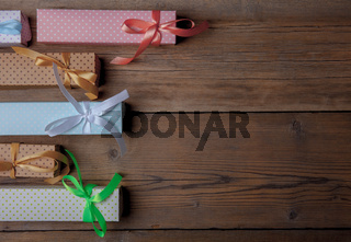 top view of colored gift boxes on wooden background