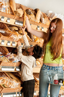 Grocery store shopping -  Red hair woman with child