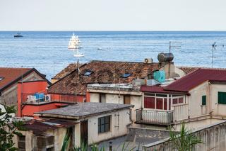 urban houses in Giardini Naxos and ships in Sea