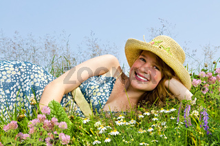 Young girl laying on meadow