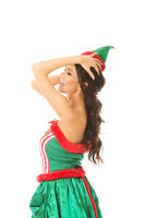 Side view of beautiful woman wearing elf clothes, touching her head
