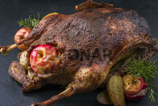 Barbecue Goose with Potatoes and Fruits