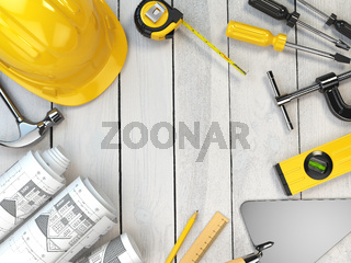Construction tools on a wooden background. Hard helmet,  trowel, drawing and level with space for text.