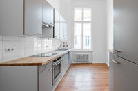 kitchen room with fitted kitchen and wooden floor,