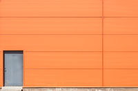 Orange wall with metal doors