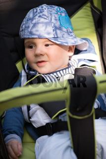 baby boy sitting in the pram