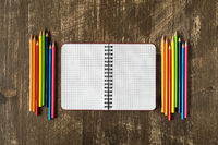 Blank spiral notebook and colored pencils