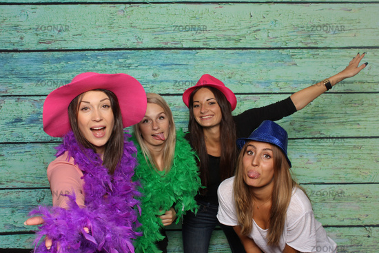 4 fine ladies in front of a photo box - fun with photo booth
