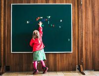 Schoolkid on blackboard