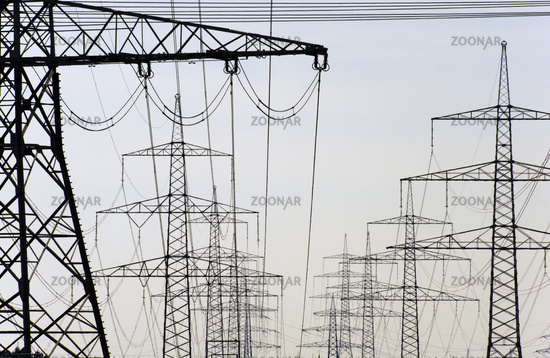 many high-voltage pylons for transporting electricity from a power plant