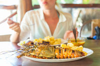 Grilled lobster served with potatoes and coconut sauce.