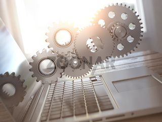 Laptop and gears. Computer technology, online support pc service concept.