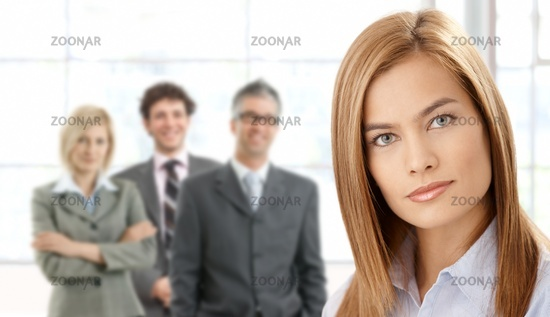 Businesswoman in focus with team