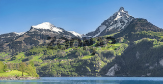 Swiss Alps mountains and lake on a sunny day