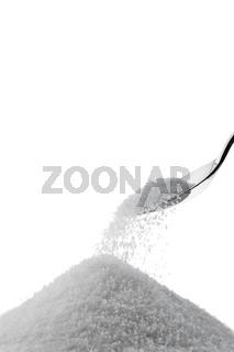 Kristall Zucker auf einem Löffel