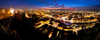 Graz aerial night panoramic view from Schlossberg