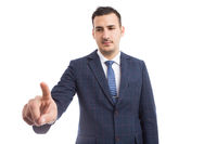 Financial broker or sales person touching invisible screen