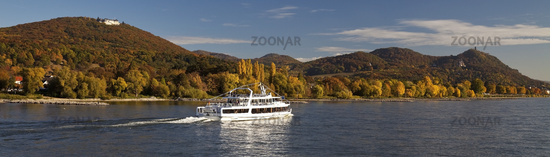excursion boot on river Rhine with mountains Drachenfels and Petersburg, Koenigswinter, Germany