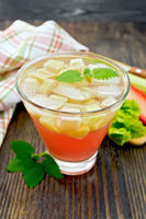 Lemonade with rhubarb and mint on wooden table
