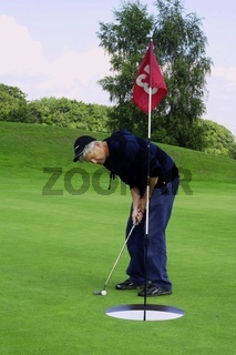 Concentration as  putt is taken.