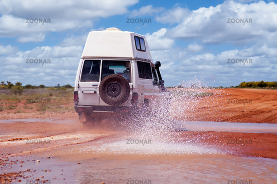 4WD crossing a floodway on an off road track