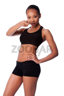 Happy healthy fit black asian woman pointing finger