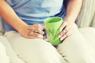 close up of young woman with tea cup