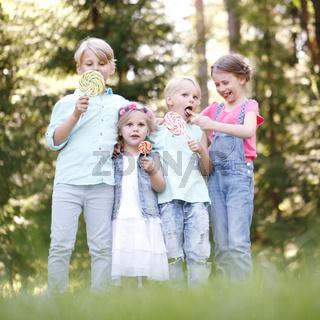 Happy children with lollipops