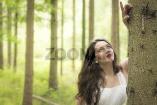 Brunette girl in the forest