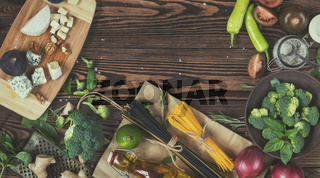 Fresh organic vegetables and kitchen items on wooden background. Top view. Copy space