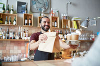 man or waiter serving customer at coffee shop